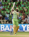 Chris Gayle smashes a six over long-on