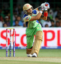 Virat Kohli plays a sweep shot during his innings