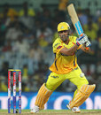 MS Dhoni smacks a ball through the offside