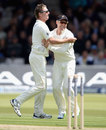 Bruce Martin celebrates his wicket with Brendon McCullum