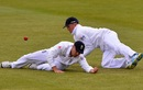Jonathan Trott drops a catch after diving in front of Graeme Swann