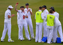 James Anderson holds the ball aloft in recognition of his five-for