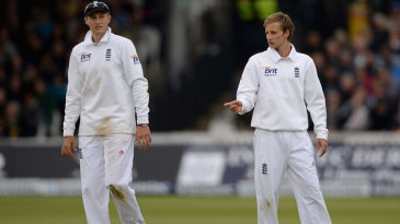 Joe Root and twelfth man Billy Root in the field
