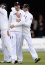 James Anderson gets a hug from Graeme Swann