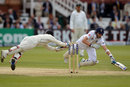 Joe Root dives to make his ground as BJ Watling narrowly misses a spectacular stumping