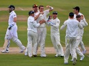 Tim Southee is mobbed after picking up Matt Prior's wicket