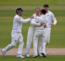 Kane Williamson is congratulated on removing Jonathan Trott