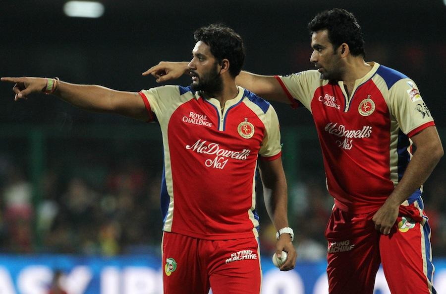 Zaheer Khan helps Ravi Rampaul with the fields