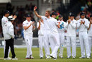 Stuart Broad holds the ball up to the crowd after taking his fifth wicket