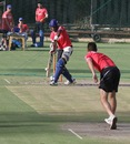Shaun Tait bowls to Kevon Cooper during a practice session