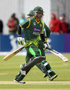 Mohammad Hafeez takes a run