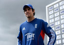 Alastair Cook addresses the media under cloudy skies