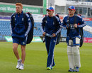 Jonny Bairstow, Joe Root and Ian Bell walk through a Headingley shower