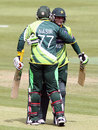 Mohammad Hafeez is congratulated by Nasir Jamshed on his century