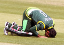 Mohammad Hafeez goes down to the turf after completing his century, Ireland v Pakistan, 1st ODI, Dublin, May 23, 2013