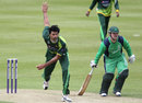 Mohammad Irfan bowls a delivery while Paul Stirling looks on