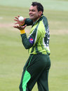 Mohammad Hafeez has a laugh before bowling a ball