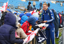 Stuart Broad signs autographs with rain delaying the start