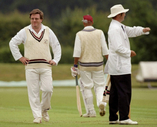 Wisden's Steven Lynch grimaces as the umpire signals a boundary, Wormsley, June 29, 1999