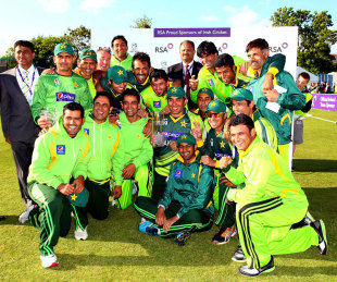 The victorious Pakistan team pose with the series trophy, Dublin, May 26, 2013
