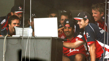 England players find entertainment on a laptop after play was called off due to rain