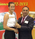 Mariko Hill collects her Hong Kong Woman Cricketer of the Year trophy from outgoing HKCA President Capt. Saleem Ahmed Shahzada at the HKCA 2012-13 Awards Dinner at Kowloon Cricket Club on 5th June 2013
