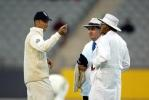 England captain Nasser Hussain (left) discusses the light conditions with umpires Doug Cowie (centre) and Srinivas Venkataraghavan from India. The umpires allowed play to continue under artificial lighting until the scheduled minimum number of overs were bowled. 3rd Test: New Zealand v England at Eden Park, Auckland, 30 March-3 April 2002 (2 April 2002).