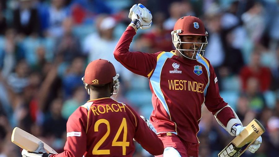 Denesh Ramdin leaps in the air after the win