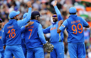 Ravindra Jadeja celebrates with team-mates after picking up a wicket, India v West Indies, Champions Trophy, Group B, The Oval, June 11, 2013