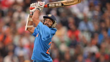 Shikhar Dhawan hits a six over third man to reach his century