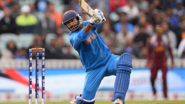 Dinesh Karthik drives through the covers