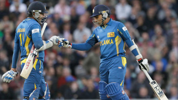 Kumar Sangakkara and Mahela Jayawardene punch gloves during their partnership