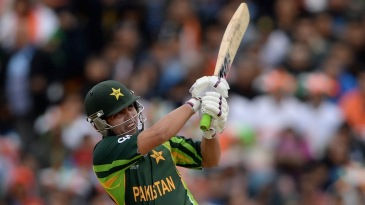 Kamran Akmal smashes one on the on side