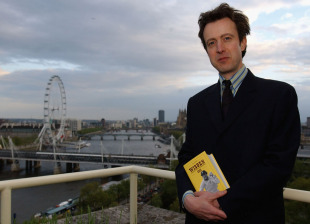 Editor Tim de Lisle with a copy of the 2003 <i>Wisden Cricketers' Almanack</i>