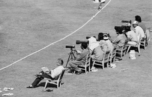 John Woodcock (first from left), on his last official tour as cricket correspondent of the <i>Times</i> sits with photographers behind the boundary, first Test, Pakistan v England, Lahore, 25 November 1987
