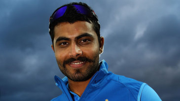 Ravindra Jadeja poses with the Man of the Match and golden ball awards