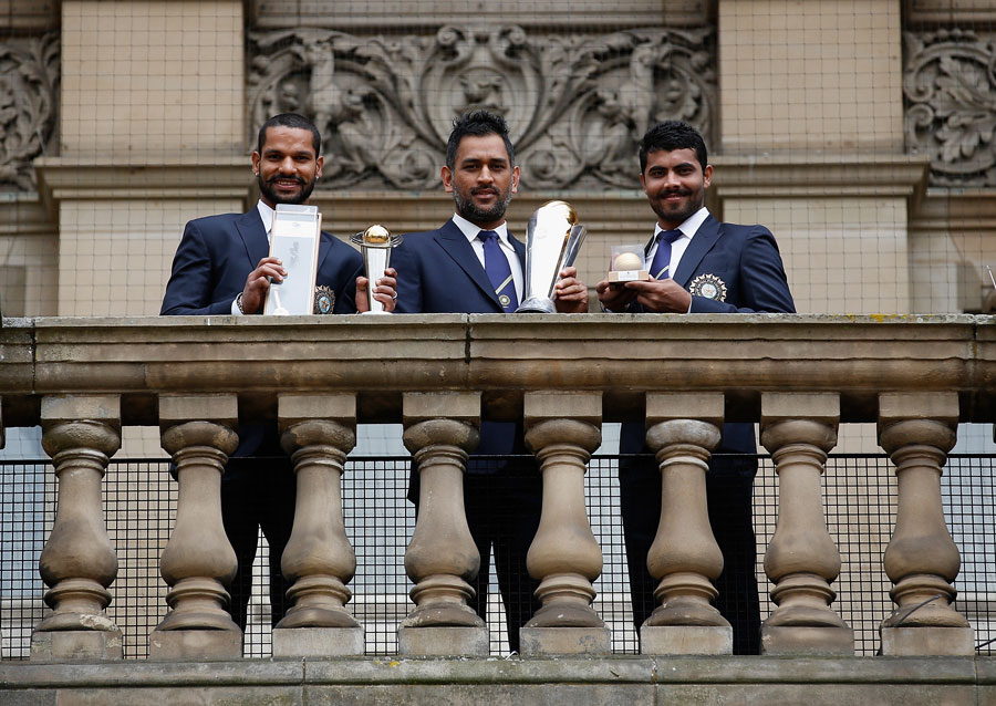 Shikhar Dhawan, MS Dhoni and Ravindra Jadeja with their respective trophies
