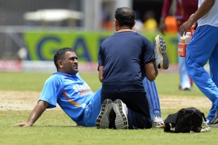 MS Dhoni struggled with an injury, West Indies v India, West Indies tri-series, Kingston, June 30, 2013