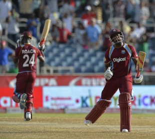 Kemar Roach and Tino Best saw West Indies through in a tense finish