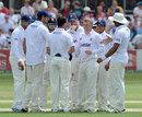 Tom Craddock is congratulated on his five-four, Essex v England, 2nd day, Chelmsford, July 1, 2013