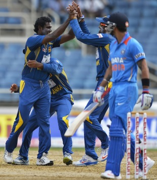 Angelo Mathews is mobbed after removing Virat Kohli, India v Sri Lanka, West Indies tri-series, Kingston, July 2, 2013