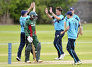 Neil Carter celebrates with team-mates after dismissing Alex Obanda, Scotland v Kenya, ICC World Cricket League Championship, Aberdeen, July 2, 2013