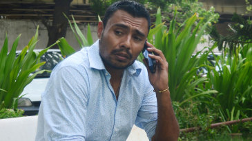 Danish Kaneria on the phone outside his apartment