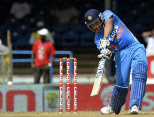 Rohit Sharma strikes the ball through the covers, India v Sri Lanka, West Indies tri-series, Port-of-Spain, July 9, 2013