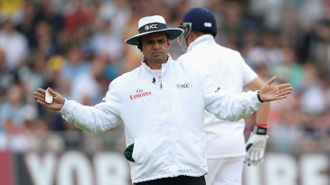 Aleem Dar signals a wide off the first ball of the series