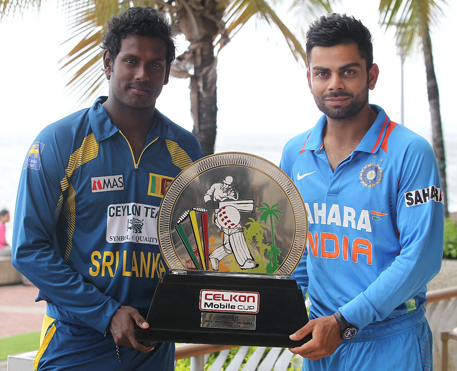 Virat Kohli and Angelo Mathews pose with the trophy