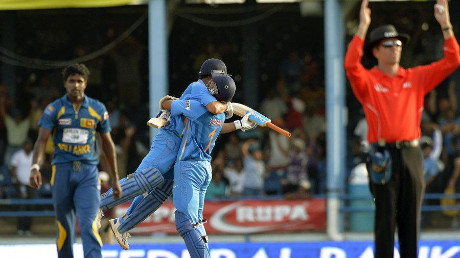 Shaminda Eranga is forlorn while MS Dhoni and Ishant Sharma celebrate victory