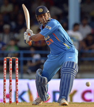 MS Dhoni is set to launch the ball out of the ground, India v Sri Lanka, tri-series final, Port-of-Spain, July 11, 2013