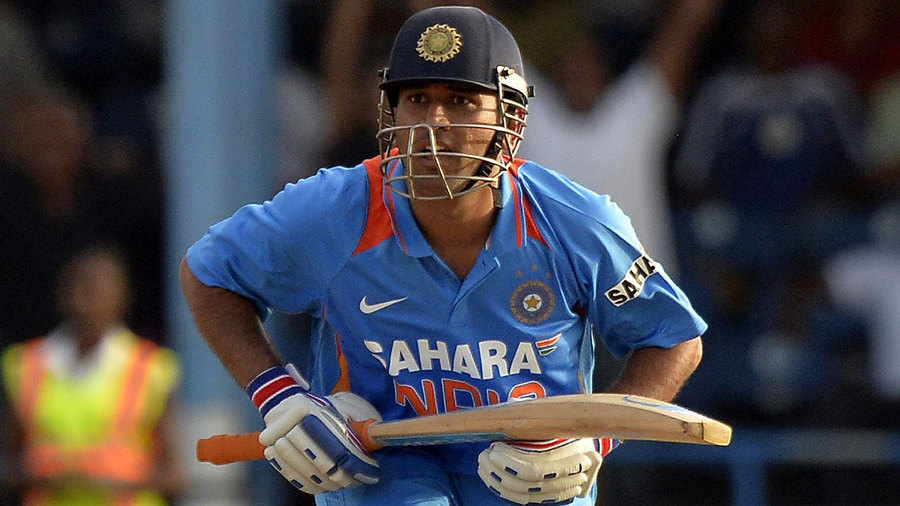 MS Dhoni watches the winning hit clear the rope