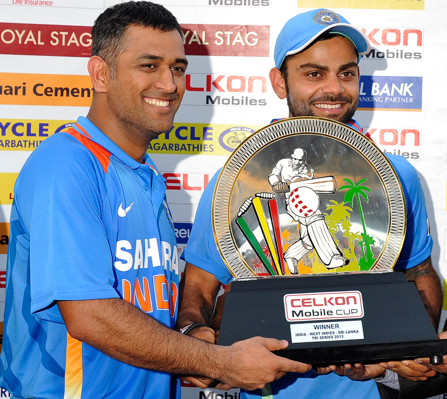 India's captains, MS Dhoni and Virat Kohli, with the tri-series trophy